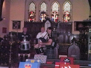 Pipers playing at St Bartholomew's Anglican Church Dinard