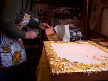 Karen working with gold leaf