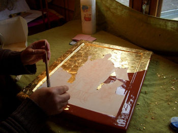 Placing gold leaf on Icon of St Ouen