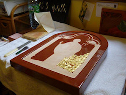 Gold leaf is placed on to the icon